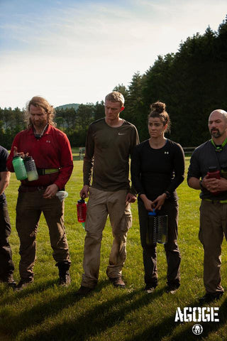 Rachel Lotz lined up with other Spartan Competitors as they hydrate for the next AGOGE Challenge