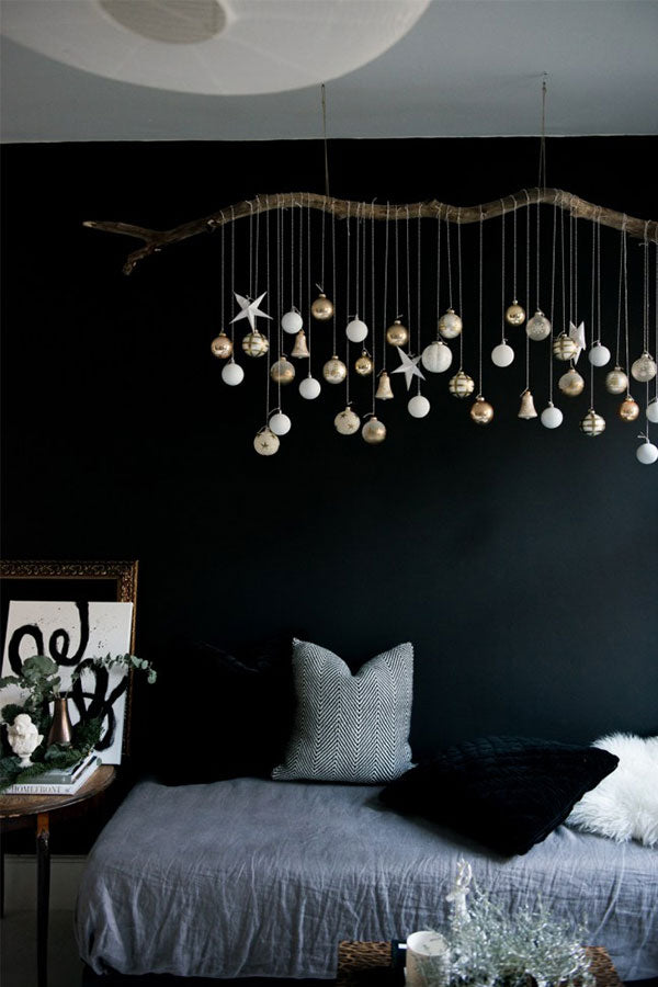 A Natural & Glamorous Christmas Room, complete with bunting and a branch adorned with hanging baubles
