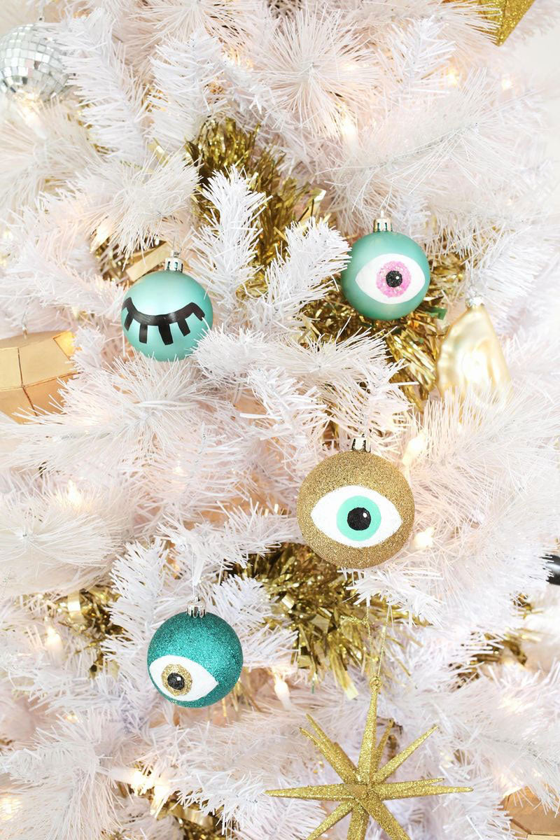 How to create your own DIY Hand-Painted Eye Ornaments for your Christmas tree, from A Beautiful Mess