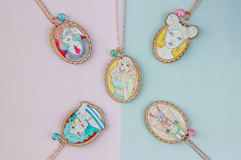 Rose gold and wooden pendant necklaces with Watercolour Illustration by illustrator and designer Karen Murray of A Rose Cast