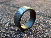 High contrast stainless damascus steel and matte black titanium men's wedding band