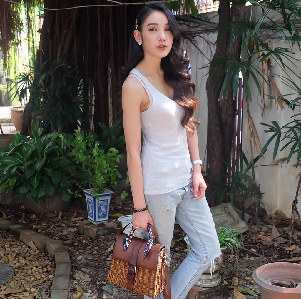 Pat looks gorgeous in casual outfit carrying LENA wicker bag