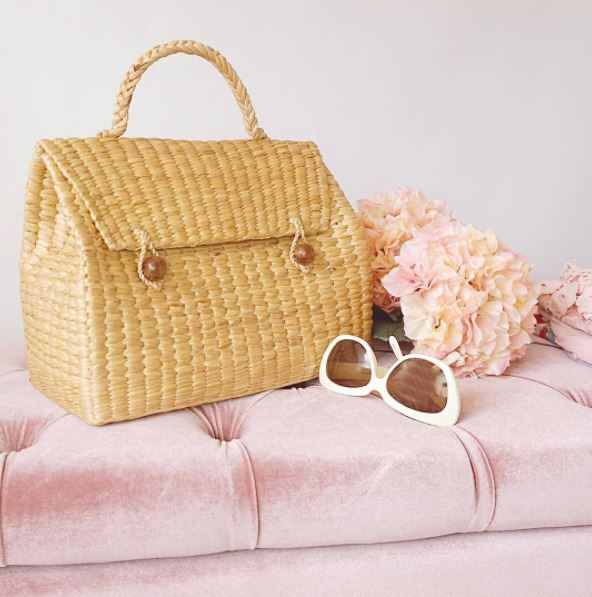 Triangle straw handbag with chic sunglasses