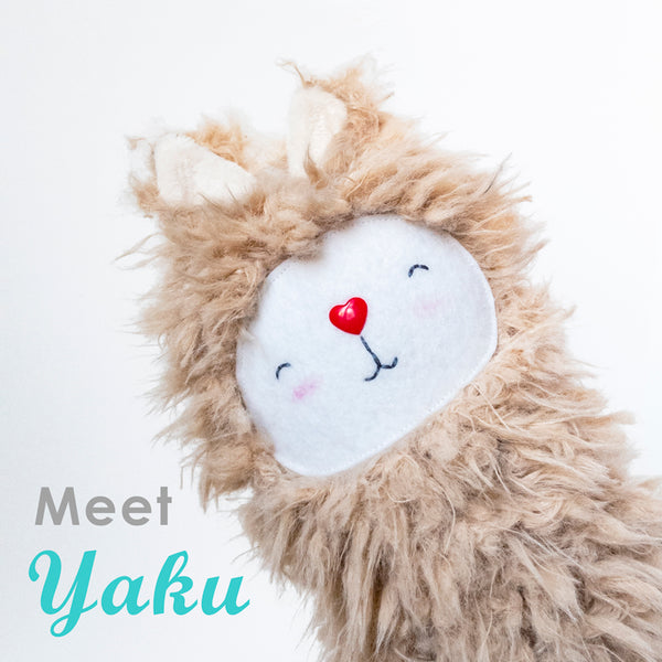 "Picture of a stuffed llama with the text""Meet Yaku"""