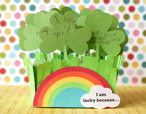 Paper cut clover with a rainbow