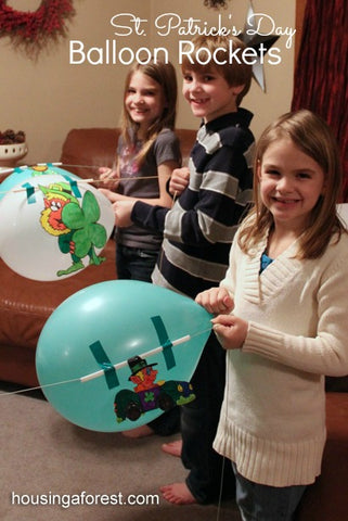 Kids with balloon and leprechaun
