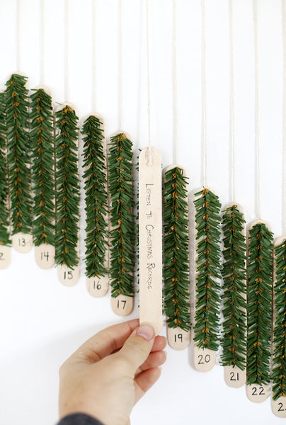 stick covered with pine craft advent calendar