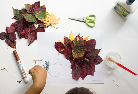 Kid hand coloring our autumn leaves hedgehog nose