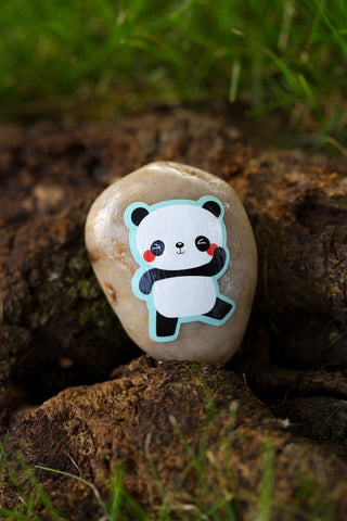 Sticker of a panda glued on a rock
