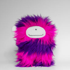 Big plush monster with purple and pink stripes and a big smile