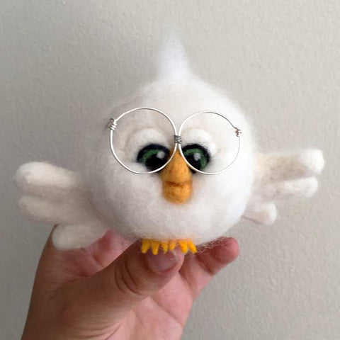 Needle felting bird with big glasses, front view