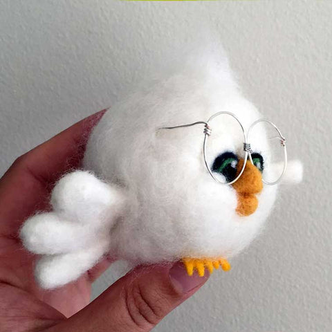 Needle felted bird with big glasses, profilew view