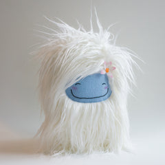 Fancy plush yeti monster with flower in her hair