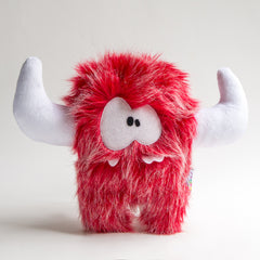 Big red plush monster with 3 teeth and hornes
