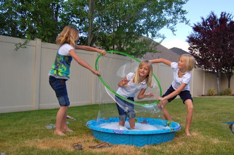 3 kids making giant bubbles