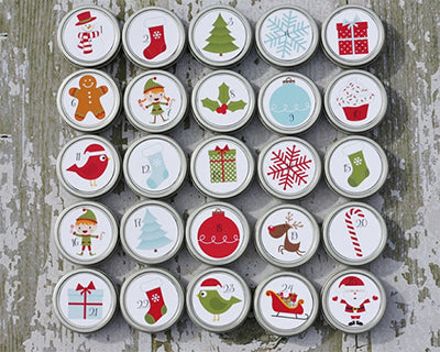Tin can magnet advent calendar with Christmas images