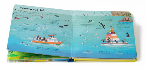 "Open booke from ""Look inside our world"" the watery world. With boat on the sea"