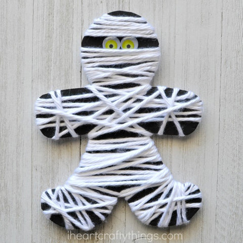 Mummy wraped in yarn fine motor skill