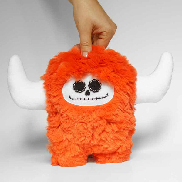 Day of the dead orange stuffed monster, front view 2