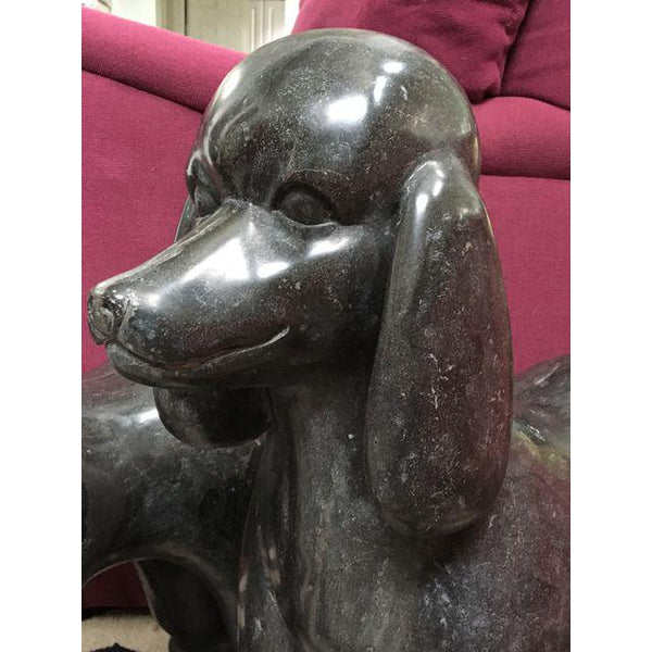 Pair of black marble poodle statues close up