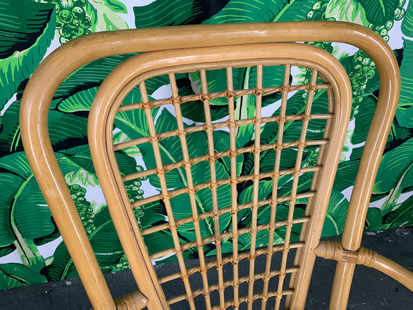 Set of Four Rattan Fan Back Arm Chairs close up