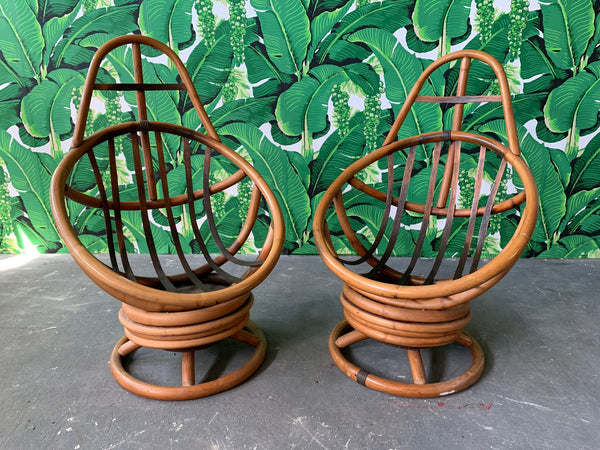 Pair of Mid Century Rattan Swivel Lounge Chairs
