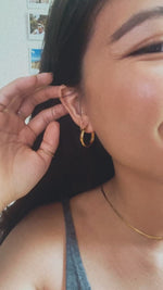 Load and play video in Gallery viewer, Midi Segmented Circle Hoop Earrings
