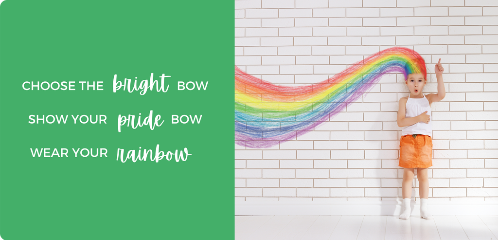 Choose the bright bow. Show your pride bow. Wear your rainbow. - Little girl with rainbow hair standing at a brick wall