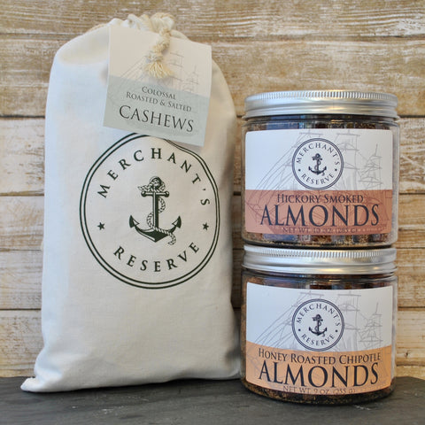 Merchant's Reserve Campfire Combo Bundle: 10 oz. jar of Hickory Smoked Almonds, 9 oz. jar of honey roasted chipotle almonds, 1 lb. bag of Jumbo Cashews in reusable cotton cargo bag