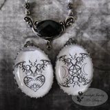 Black And White Tribal Bat Heart Or Bat Moon Amulet