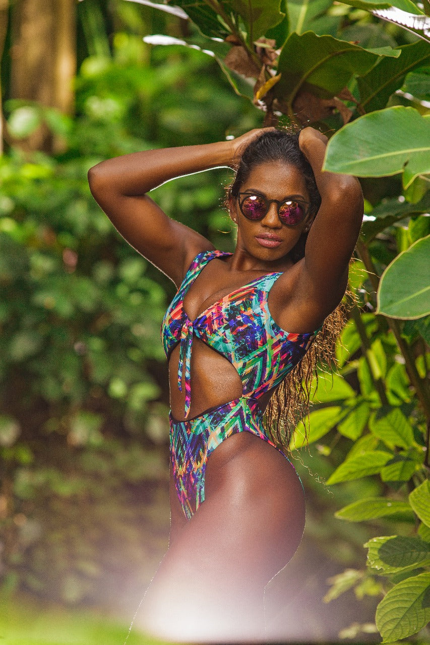 The most wanted one piece of 2020! Our Mia Monokini is a reversible one piece swimsuit with solid black on the reverse side with a high waist high cut bottom. Constructed to subtly enhance your curves. Doubles as a body suit. Moderate coverage
