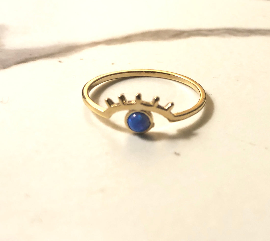 cosmic blue eyed wink ring