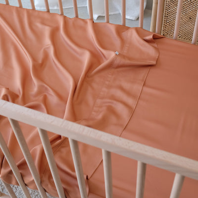 Bamboo cot sheets rust colour