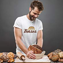 baker holding baked sourdough bread placed in banneton bread proofing basket