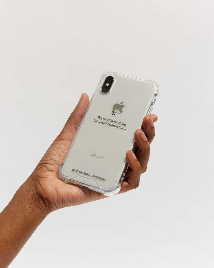 We're Not Really Strangers phone case shown in person hand to showcase size scale in black text
