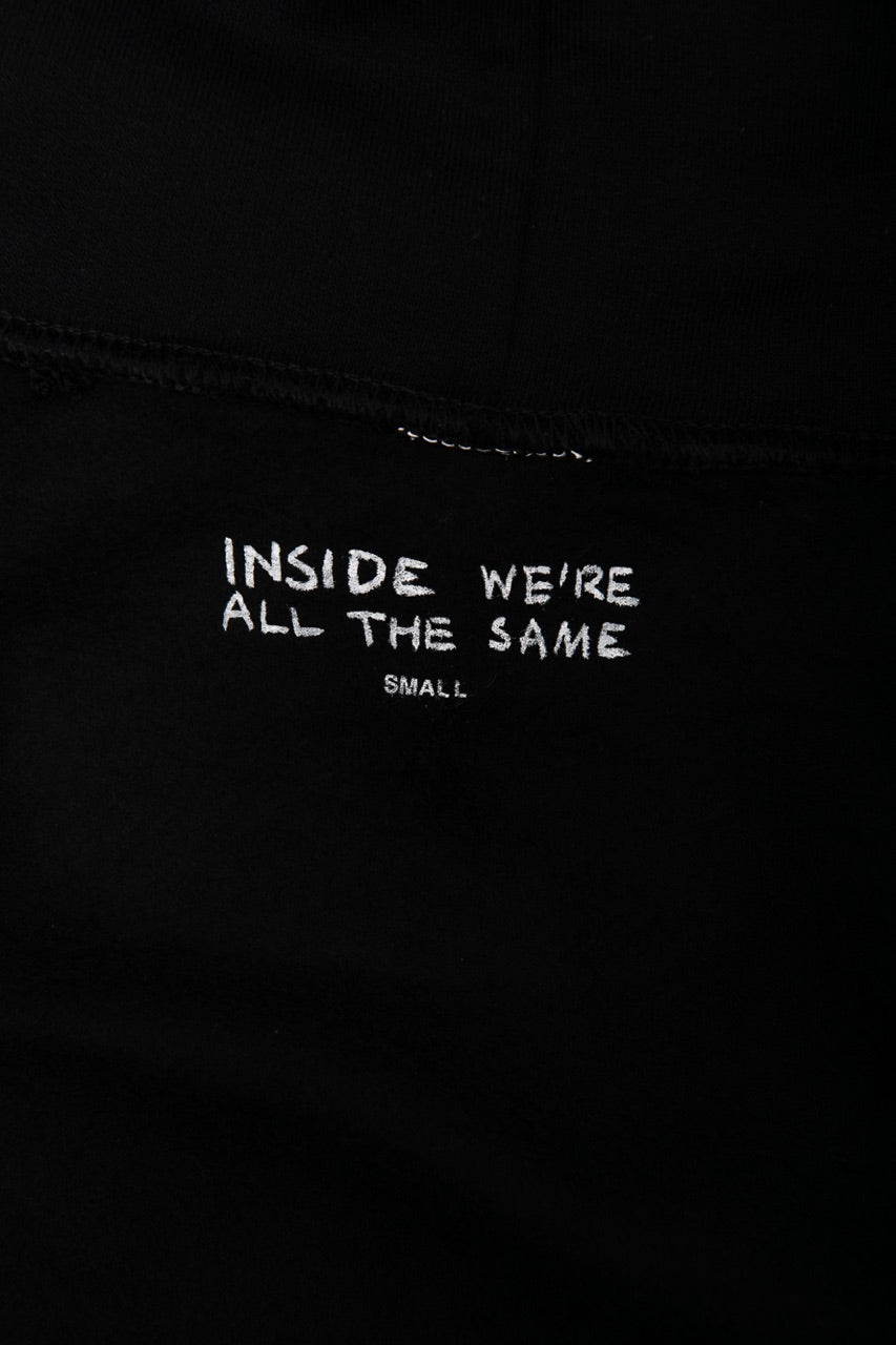 Inside view of sweatshirt collar stating Inside we're all the same