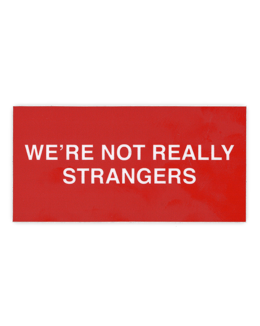 Close up flat lay of red We're Not Really Strangers Logo Sticker