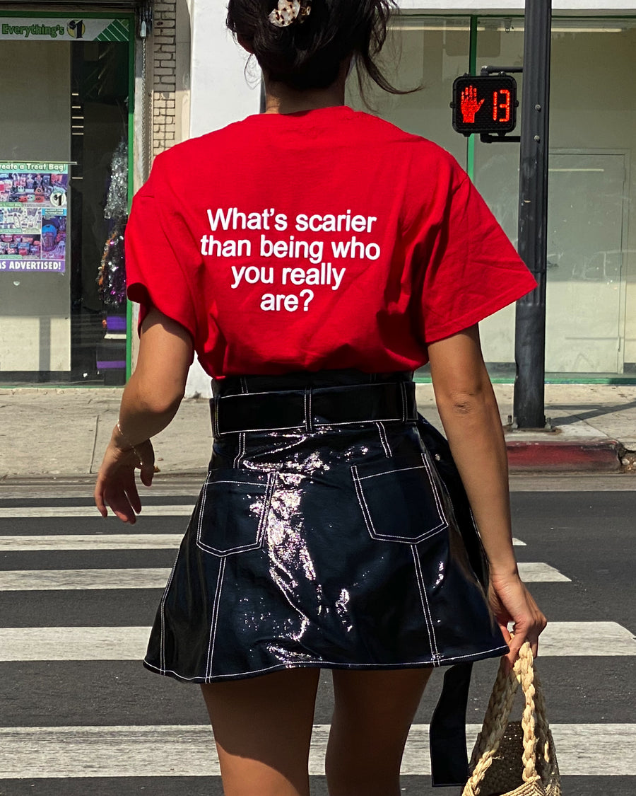 We're Not Really Strangers Red Tee shown on female model wearing it and zoomed in