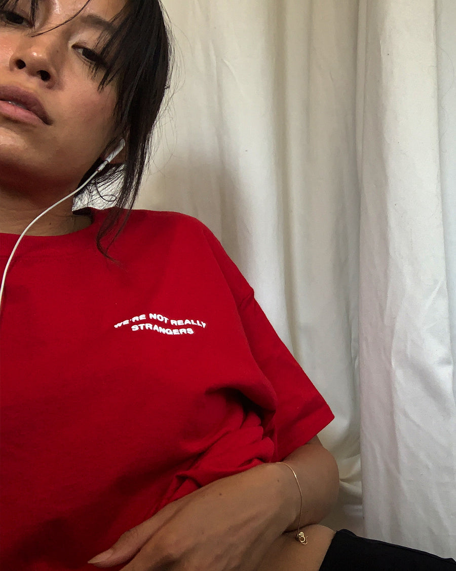 We're Not Really Strangers Red Tee on body