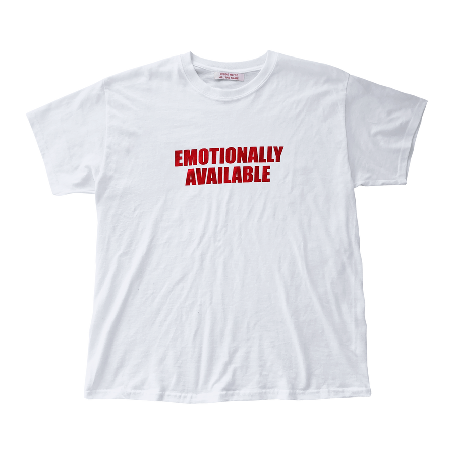 Flat lay of white tshirt with red text saying Emotionally Available