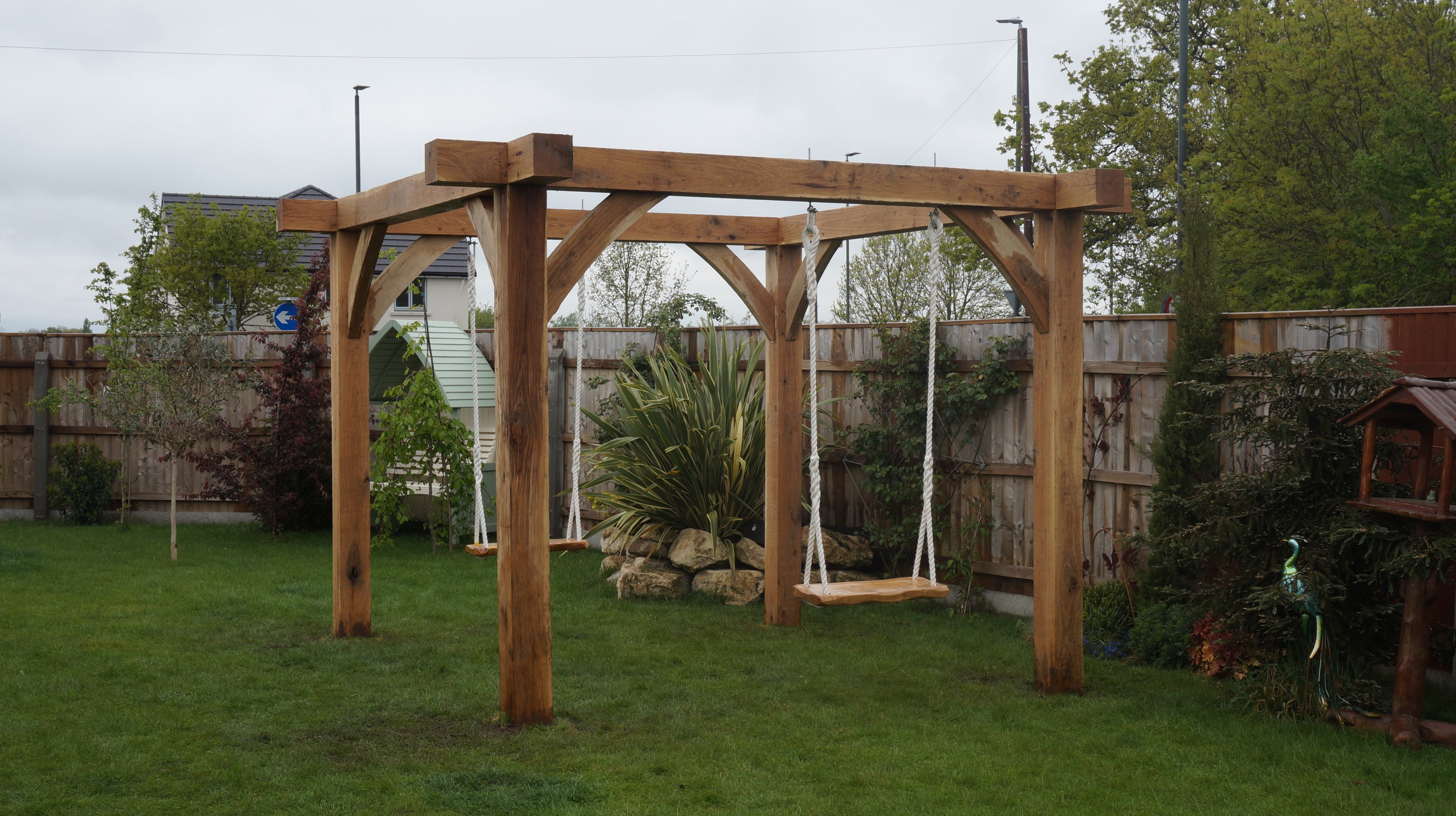 Design, Build & Installation of a Solid Oak Pergola with Natural Edged Oak Swings