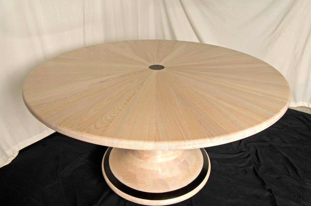 Solid Ash Pedestal Oval Dining Table with Wenge Detailing. Design by The Fine Wooden Article Co.