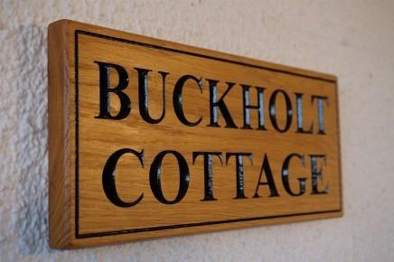 A solid oak rectangular House Name Sign, Traditional, bespoke, hand engraved, High Quality, durable, crafted in our wood working workshop,The Fine Wooden Article Company, Gloucestershire, UK