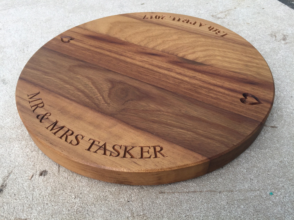 Bespoke engraved solid oak / walnut large round cake / cheese board gifts & accessories handcrafted from sustainable wood by The Fine Wooden Article Company.