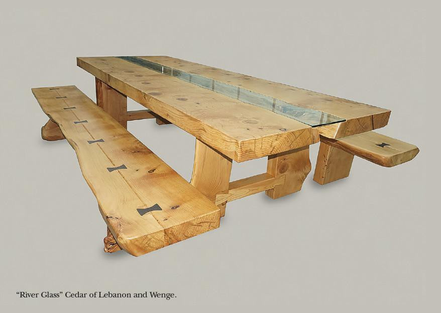 An exquisite Cedar of Lebanon banquet dining table & benches (seats 16) designed with dovetail joint legs & butterfly keys. Hand crafted in Gloucestershire, UK. The Fine Wooden Article Company.