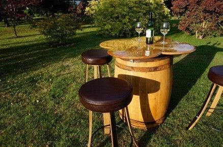 Four-leaf clover table from vintage Oak wine barrels with stools: home interiors, restaurant & catering events. Handcrafted in our Gloucestershire workshop. The Fine Wooden Article Company.