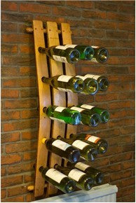 A 15 bottle wall-mounted wine rack designed from a vintage Oak barrel stave for home & commercial interiors, handcrafted in our Gloucestershire workshop, UK. The Fine Wooden Article Company.