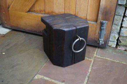 Solid Oak Doorstop for the home, handcrafted from a sustainably sourced reclaimed Dock Beam with wrought iron mooring eye handles, Gloucestershire workshop, UK. The Fine Wooden Article Company.