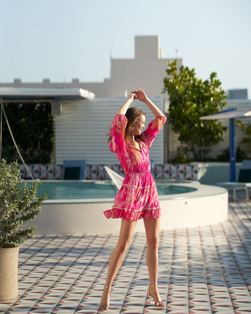 Dancing on a rooftop in a pink dress