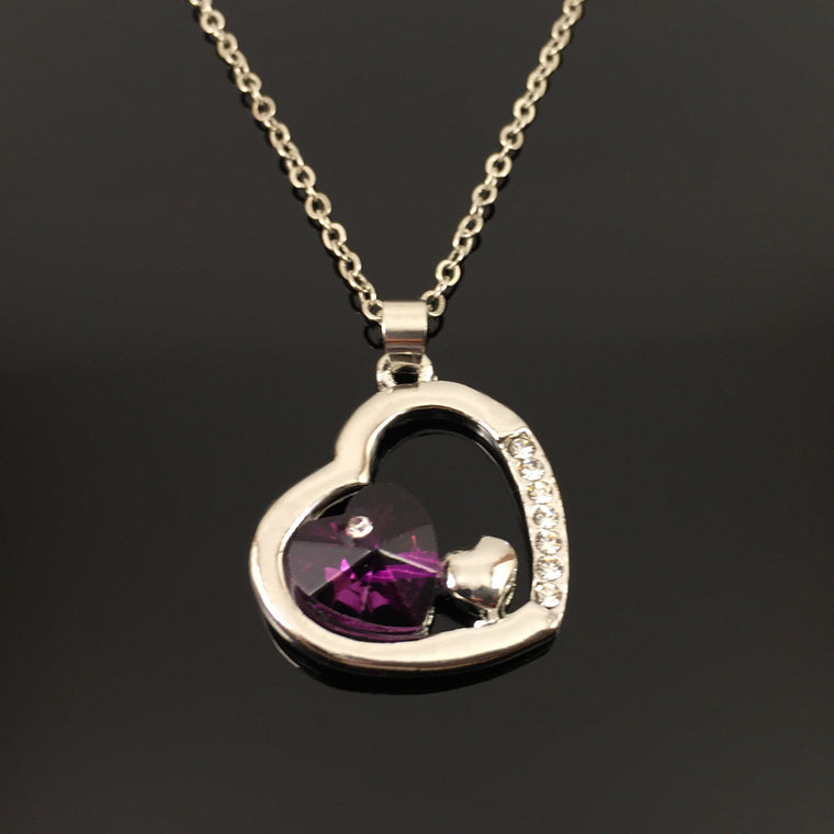 TWO HEARTS IN A HEART NECKLACE